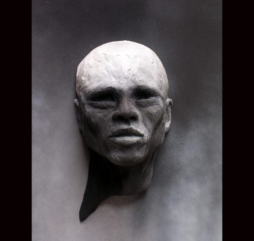 Emerging Man by Tomi LaPierre. (Metal Wall Sculpture)