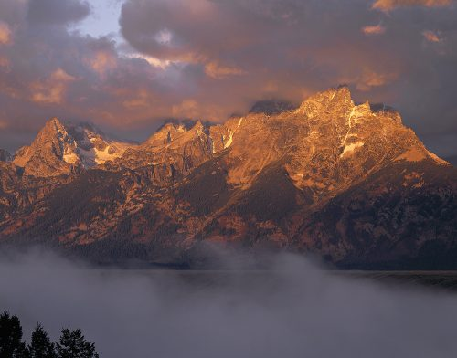 Stormy Sunrise Teton Range by John Barger. (Photography)