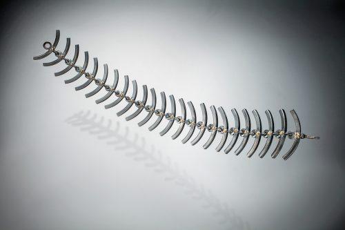 Curved Linkage by Ilene Schwartz. (Hand-made Silver Bracelet)