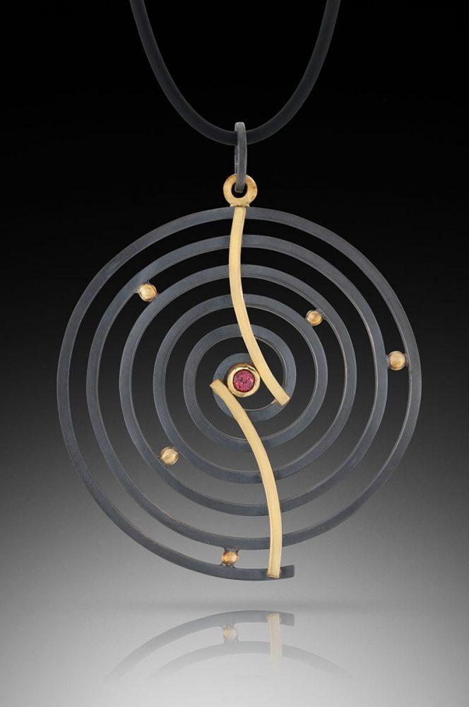 Curved Spiral Pendant by Ilene Schwartz. (Hand-made Silver pendant)